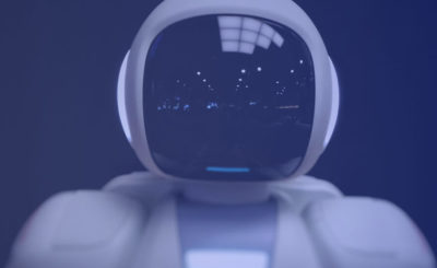 Robot with the reflection of the room on his face